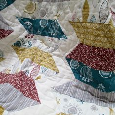 The Annali quilt features hand-drawn nature prints in a sophisticated palette for a crisp, contemporary feel