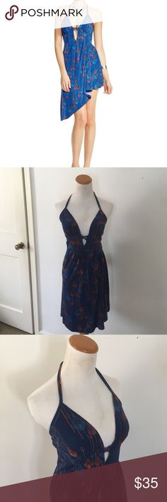 Free People NWT Tropical Dream Halter Dress Sexy and fun summer dress! Lowcut halter top with keyhole. Asymmetrical hem, lots of stretch. Free People Dresses Asymmetrical