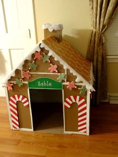 I wanted to decorate my dogs crate for Christmas so I built this Gingerbread dog house from a cardboard box. She can use it as an indoor dog house or I can use it to cover her crate when we have company over!
