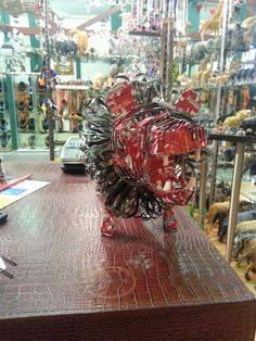 Recycled Coca Cola cans. . African lion available at RedShed. Just B