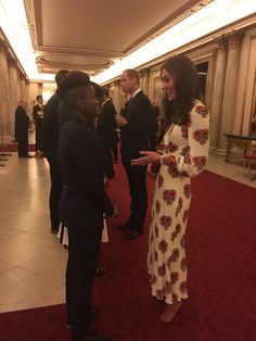 The Duke and Duchess have joined other royals at Buckingham Palace tonight for a reception honoring Great Britain's Olympic Team. Kate is w...