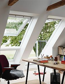 A great example of the Velux windows Neil and Jackie used in the church, utilizing the roof space by having windows that open into a balcony