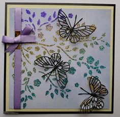 'Apple Blossom Butterflies' card.  Imagination Craft's - Black shiny card. 'Apple Blossom' stencil.  'Blue linen' card. Metal spatula.  Amethyst, Turquoise and Gold shine Sparkle Mediums.