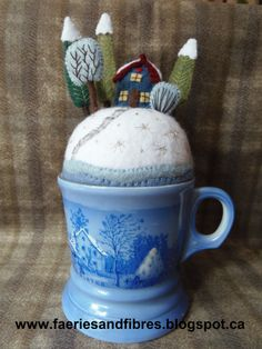 """I found this mug at a thrift store. Around the base are the words """"Farmers House in Winter so I made a farmer's house pincushion in winter!"""