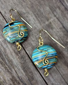 gold wire earrings with round glass beads…