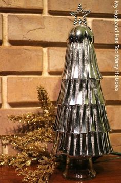This plastic spoon Christmas Cone Tree is made with small silver plastic spoons from the Dollar Store!
