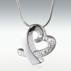 Beautiful heart necklace that can hold cremation remains.