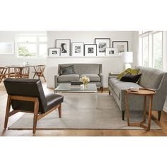 run a gallery shelf across the wall, line with pictures..TV is where love seat is...