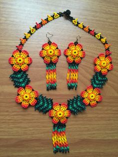 A personal favorite from my Etsy shop https://www.etsy.com/listing/271955116/huichol-beaded-necklace-with-earrings