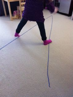 "gross motor activity - walk the ""V"" shaped line, can do on all fours too"