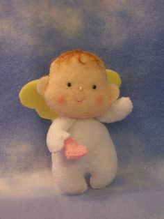 This little cupid is getting geared up for Valentine's Day. Felt Fairy, Baby Fairy, Felt Dolls, Paper Dolls, Baby Dolls, Felt Christmas Ornaments, Christmas Crafts, Christmas Ideas, Felt Angel