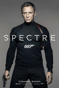 """It's James Bond in a tactleneck! The new poster for the 24th Bond outing, Spectre, has the master spy ditching the tuxedo for a tight dark turtleneck. Star Daniel Craig gives his icy blue-eyed lethal stare, gripping his Walther PPK and standing with his legs spread just wide enough for it to be a bit unusual (and is """"Coming Soon"""" rather strategically placed?). Behold the full poster: [ew_image nid=""""2141278"""" align=""""left"""" width=""""612"""" height=""""380""""]"""
