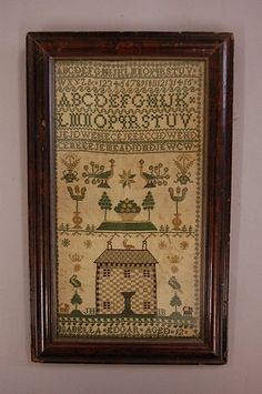 Lot: 2114: A charming house sampler by Isabella Edgar aged 1, Lot Number: 2114, Starting Bid: £150, Auctioneer: Kerry Taylor Auctions, Auction: Vintage Fashion, Accessories, Textiles, Date: April 1st, 2008 CDT