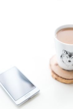 Free stock photo of coffee, mug, smartphone, desk