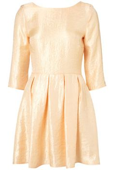 Shimmer Skater Dress in peach. Completely adorable look for a night out!
