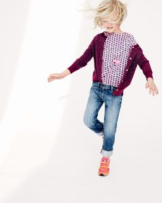 J.Crew girls' metallic-striped cardigan, button-back shirt in ink-drop heart, Riley jean, animal pendant necklace and New Balance® for crewcuts glow-in-the-dark KE410 sneakers. To pre-order, call 800 261 7422 or email verypersonalstylist@jcrew.com.