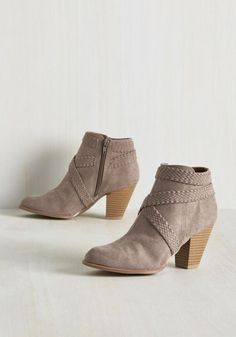 As sad as your pals are to see you go in these taupe booties, they know your sweet kicks will make the perfect travel companion. They'll reunite with you and the tapered heels and braided accents of these chic ankle boots after a few weeks, excitedly awaiting tales of your fashionable travels!