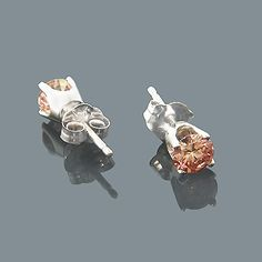 This fabulous set of 14K Pink Diamond Stud Earrings is held securely in 14K gold with four-prong settings and a push back closure for convenient wear. Each round cut diamond earring weighs approximately 1 carat, for a total diamond weight of approximately 2 carats. Luxurious and versatile, our fancy pink-treated diamond studs are an everlasting display of beauty and excellence. These round diamond stud earrings are a perfect present for any occasion, and are available in 14K #ItsHotdotcom