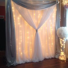 """What's in my studio today? 1 panel backdrop in white and light grey/silver and a 20"""" white feather ball on lit stand #fairylights #weddingbackdrop"""