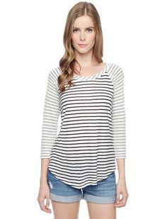 Updated raglan tee with signature stripes 	Contrast collar and sleeves 	Perfect for transition seasons