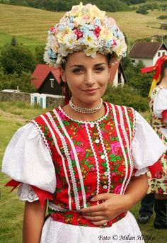 Slovak-folk-costumes: Vlachovo, Slovensko/SLOVAKIA A lovely young lady in traditional dress and headdress in Vlachovo, Slovakia. Vlachovo is a village and municipality in the Rožňava District in the Košice Region of middle-eastern Slovakia. Folklore, Costumes Around The World, Beauty Around The World, Ethnic Dress, Folk Costume, People Of The World, Ethnic Fashion, World Cultures, Traditional Dresses