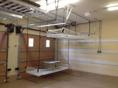 a pulley system for storage in the garage...traditional garage and shed by Inviting Spaces Garage, ideas, man cave, workshop, organization, organize, home, house, indoor, storage, woodwork, design, tool, mechanic, auto, shelving, car.