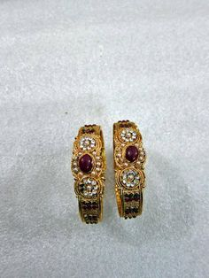 2 Pc Kundan Maroon Enamel Hinged Bangle Bracelet Traditional Gold Tone Jewelry mogulinterior. $28.99. Ideal for weddings, parties and a beautiful gift idea. Made in India.. Kundan Enamel Gold Tone Bangle With Hinged Lock.. A pair of beautifully decorated bangels with maroon and green meenakari and zircon stones.. Enhance the look of your wrist with these charming and intricately designed bangels/bracelets.. SALE FOR - 2 Bangle, PRODUCT - Enamal Kundan Bangle.