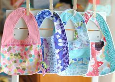 Adorable patchwork baby bibs backed with chenille.    cloverandviolet.com
