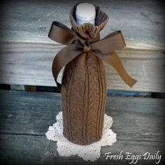Chocolate Brown Cable Knit Wine Sweater Sock Cozy with Ribbon Bow Holiday Gift Idea from Repurposed Sweater. $12.00, via Etsy.