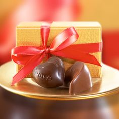 Gold Party Favor - Includes a Milk Chocolate Praline Crescent and Dark Chocolate Ganache Heart from our Godiva Gold Collection, completed with a red ribbon. Proof that good things come in small boxes.
