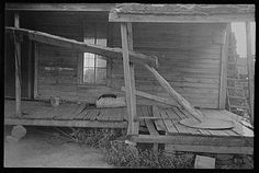 Porch of a sharecropper's cabin, Hale County, Alabama, Summer 1936. Photographer: Walker Evans. The marginal and oppresive economy of sharecropping largely collapsed during the great Depression.