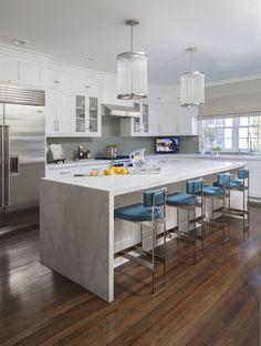 Perfect - Waterfall edge, white marble-looking granite, shaker cabinets, wood floors medium brown.
