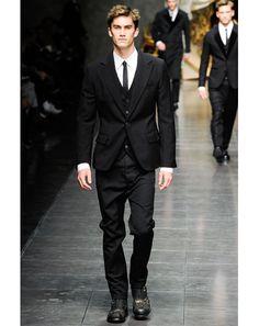 slim, black three-piece suit -- [@GQ Magazine Fall 2012 Trend]
