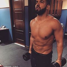 Madonna would approve! Rapper Drake flexes his muscles at the gym in new shirtless picture...