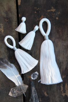 Dye your Own Tassels!  The hard part is done for you with these beautiful handmade white cotton tassels from WomanShopsWorld.  Grab your dye and get creative!  #tassels #diy
