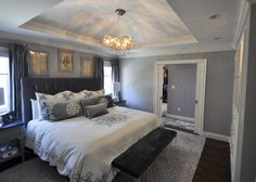 Master Bedroom with Stepped Soffit Ceiling with Solid Crown details. The Rear addition allowed for us to utilize Double Pocket Doors that lead to a Walk in Closet and Master Bath, turning this small Master bedroom, now into a Master Suite.