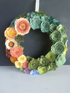 Nothing says welcome home like a beautiful flower arrangement, and this stunner is the perfect blend of sophisticated and whimsical. A 14 foam core is all dressed up with wool felt flowers & succulents in a bright array of colors. The florals are surrounded by a collar of real