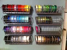Bygel wire baskets from IKEA at $1.99 each used by this crafter for ribbon storage.  She removed the wire handle and secured them directly to the wall.