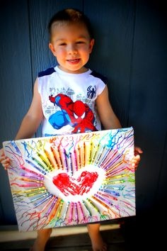 My Grandson Jake's Anniversary gift to mom and dad.  Canvas, Crayons hot glued, Fabric paint for hands, Hair dryer to melt crayons, He had a blast and it turned out so cute.