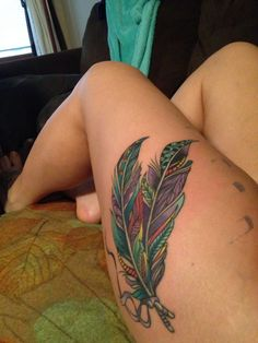 Thigh tattoo <3 feathers