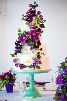 Wedding cake with climbing purple flowers by Rosalind Miller