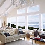Love the view!   But I think I would face the couch towards all those fantastic windows!