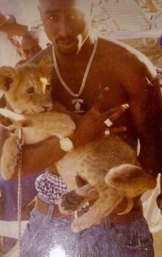This is what I call RARE. Is this a pic of Tupac holding Simba!