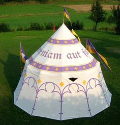 Beautiful purple and yellow paint design on a round pavilion with elements that would also work on a geteld