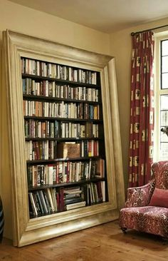 This is such an awesome bookshelf, love how it is framed.