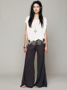 Wide leg pants, comfy oversized tank, Indian chain belt and boho adornment. Casual, bohemian winter outfit.