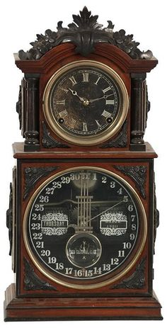 Ithaca 3 1-2 Parlor Model Mantle Clock. made for Ithaca Clock Co. Walnut case with ebonized carvings and turned columns