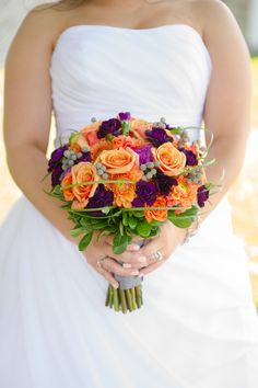 LOVED my purple and orange bouquet!! Flowers by @Shelly's Designs Florist  http://shellysdesignsflorist.com/