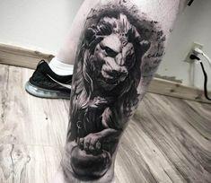 Lion statue tattoo by Mark Wosgerau