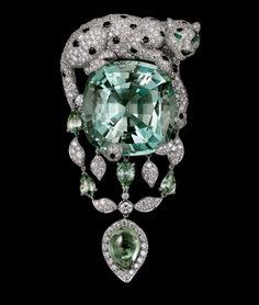 Cartier Étourdissant Collection Panthère de Cartier brooch. Platinum, green beryl, green sapphires, emeralds, onyx, diamonds.